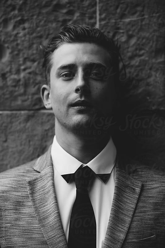 Elegant Young Man Portrait under the rain by HEX. for Stocksy United