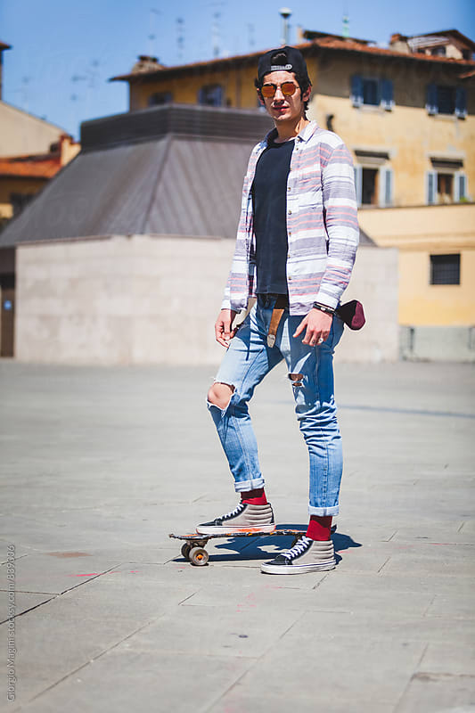 Portrait of a Teen Boy Skating in Urban Area by Giorgio Magini for Stocksy United