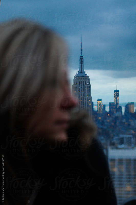 Woman and Manhattan skyline by Chelsea Victoria for Stocksy United