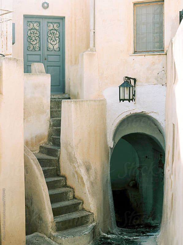 Doors and alleyway in Santorini by Kirstin Mckee for Stocksy United