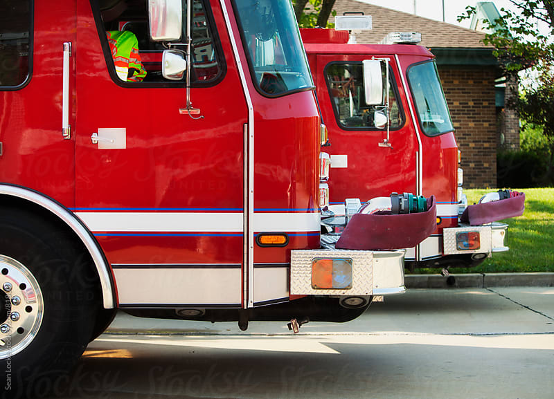 Firehouse: Fire Trucks Lined Up by Sean Locke for Stocksy United