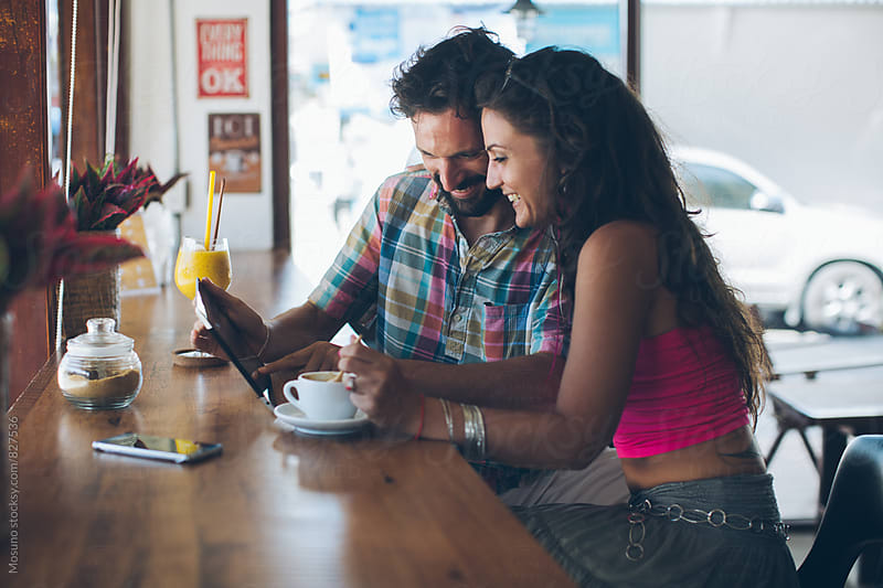 Couple Using Technology in a Cafe by Mosuno for Stocksy United