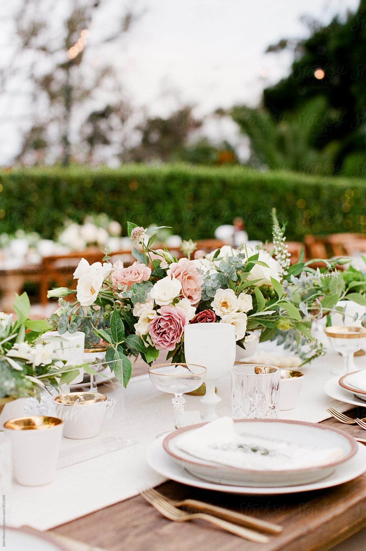 Romantic Garden Wedding Reception table by Seth Mourra - Wedding flowers, Wedding  reception - Stocksy United