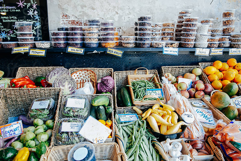 Fresh produce for sale at an urban farmer's market by Cara Dolan for Stocksy United