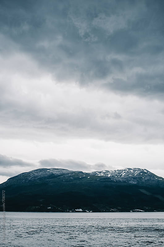 Mountains with the dark clouds by Tomas Mikula for Stocksy United