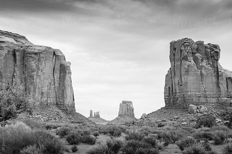 Monument Valley Utah Arizona in Black and White Under Cloudy Dramatic Desert Sky by JP Danko for Stocksy United