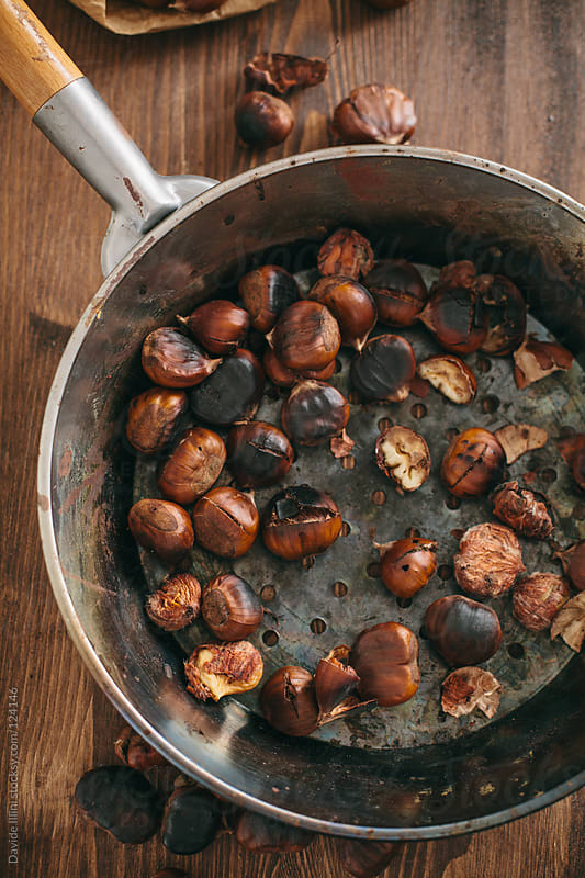 Roasted chestnuts by Davide Illini for Stocksy United