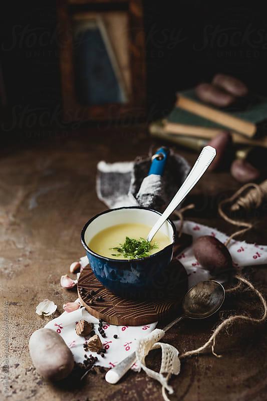 Potato soup with parsley by Tatjana Zlatkovic for Stocksy United