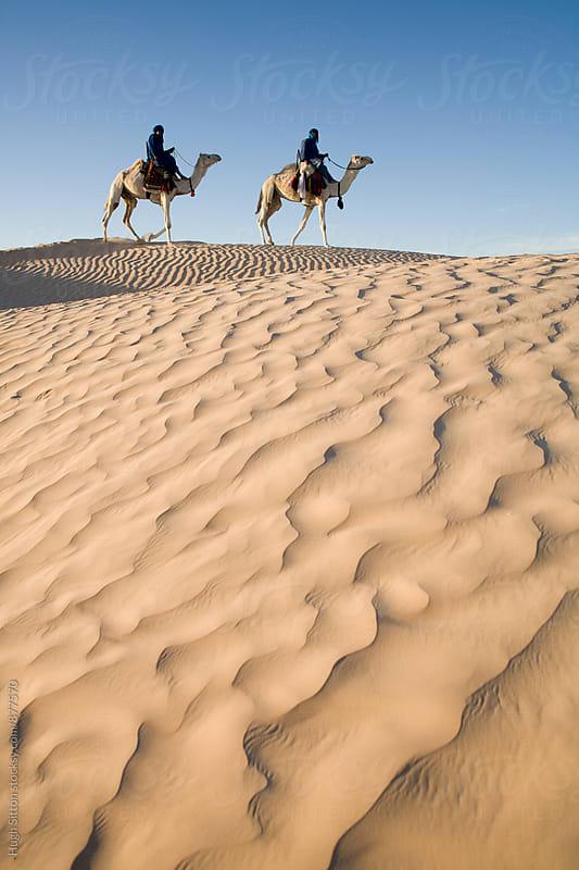 Berbers travelling across Sahara Desert.  by Hugh Sitton for Stocksy United