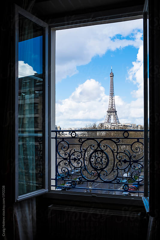 The Eiffel Tower, Paris, France, viewed through an open window. by Craig Holmes for Stocksy United