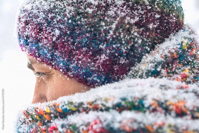 Snow-covered female face in winter by Pixel Stories for Stocksy United