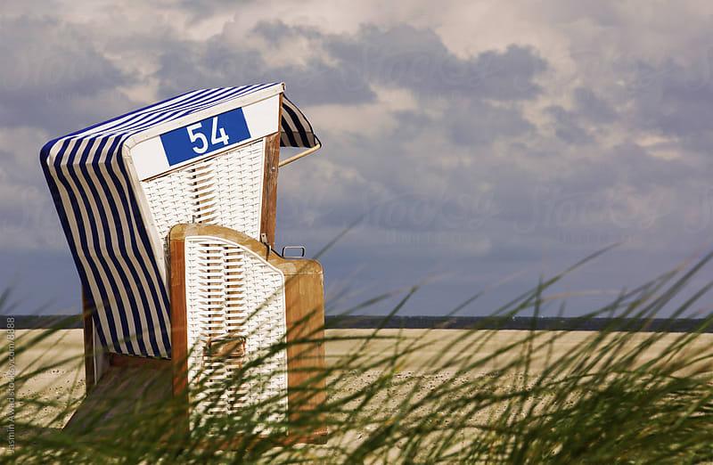 Hodded Beach Chair on North Sea Coast by Jasmin Awad for Stocksy United