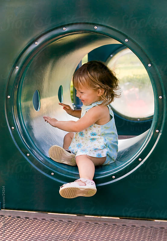 Toddler Girl Giggling and Playing at the Park by Brian McEntire for Stocksy United