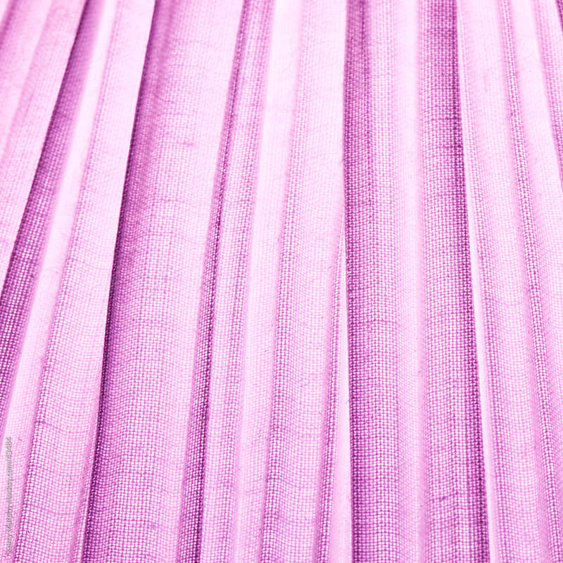 Abstract of lines on purple fabric  by Kerry Murphy for Stocksy United