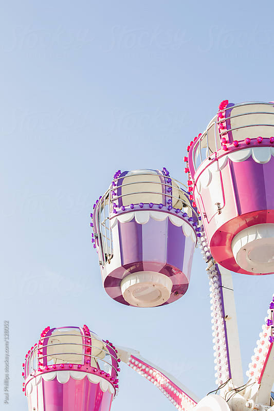 Small pastel children's ferris ride at a carnival by Paul Phillips for Stocksy United