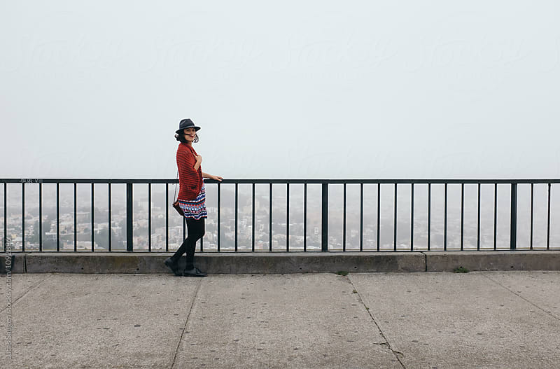 Stylish tourist at Twin Peaks viewpoint by Lucas Saugen for Stocksy United