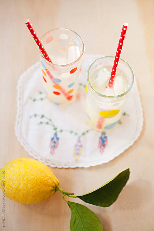 Fresh home made lemonade with retro vintage style on ply table top by Natalie JEFFCOTT for Stocksy United