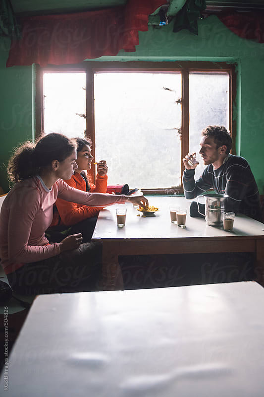 friends in a restaurant in India  by RG&B Images for Stocksy United