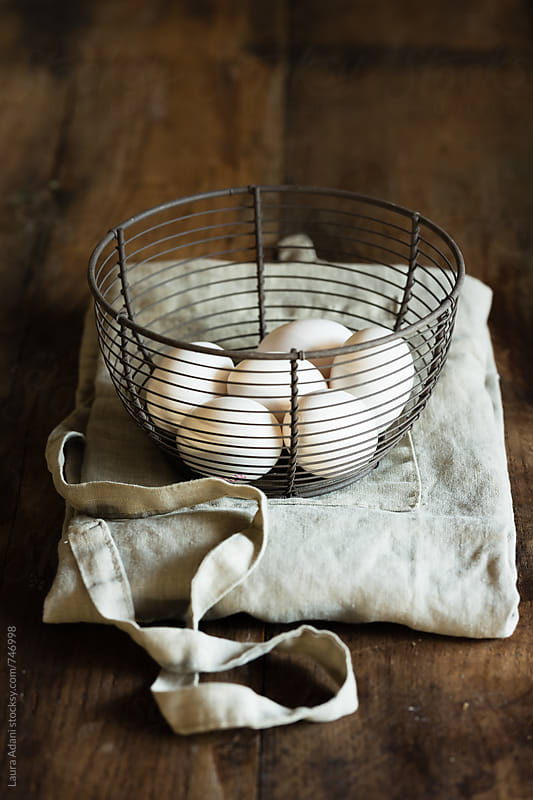 white eggs on a meta basket by Laura Adani for Stocksy United