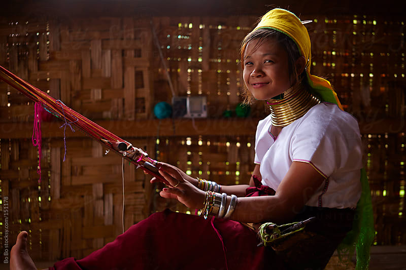Myanmar long neck girl weaving by Bo Bo for Stocksy United