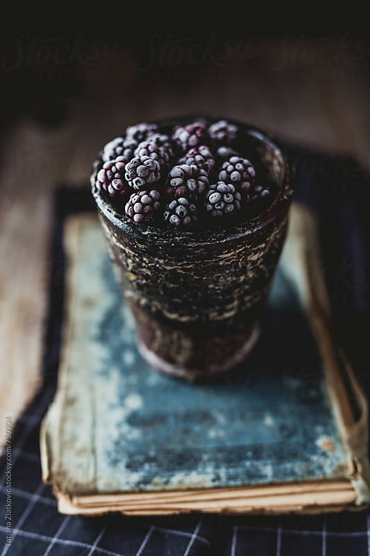 Frozen wild blackberries by Tatjana Ristanic for Stocksy United
