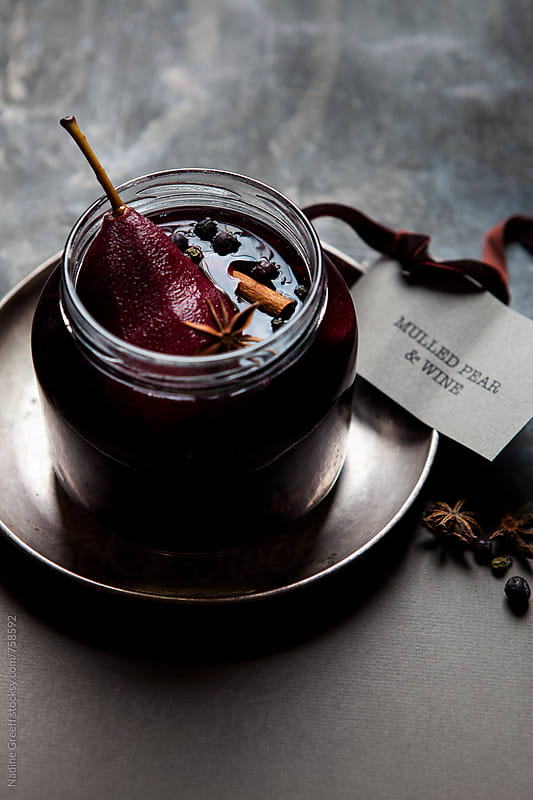 Poached pears in mulled red wine with juniper berries, cinnamon and star anise by Nadine Greeff for Stocksy United