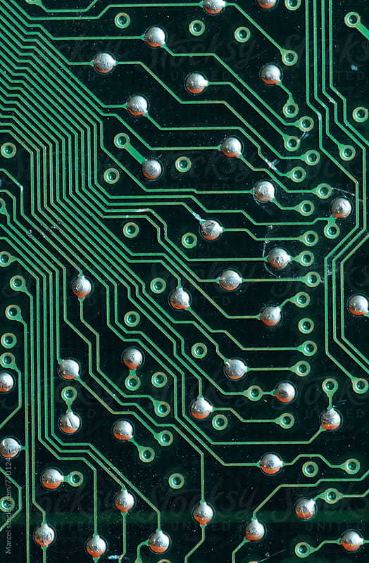 Macro of the backside of a printed circuit board of a computer by Marcel for Stocksy United