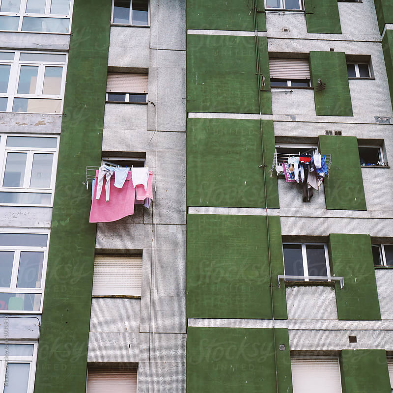 Laundry on apartment building by Marcel for Stocksy United