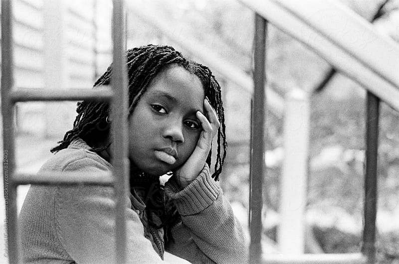 Tired black girl sitting on the steps by Gabriel (Gabi) Bucataru for Stocksy United