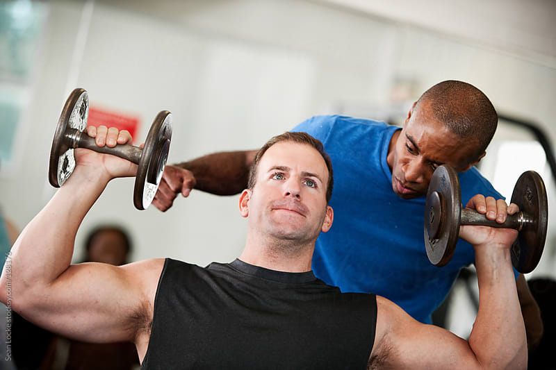 Gym: Trainer Offers Encouragement to Lifter by Sean Locke for Stocksy United