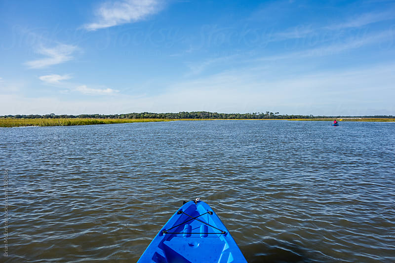 Bow of Kayak looking at Marsh Grass on Horizon in Carolina Low Country by Brian McEntire for Stocksy United