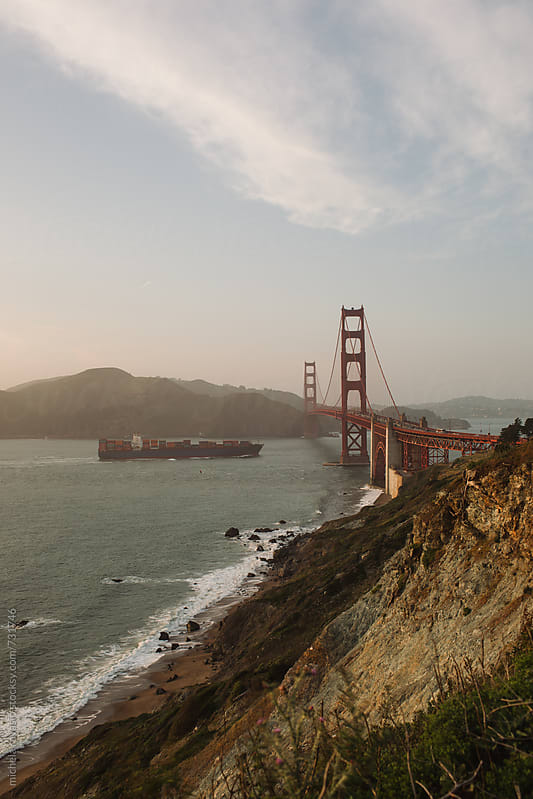 Cargo ship passing by the Golden Gate Bridge by michela ravasio for Stocksy United