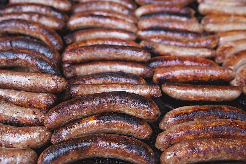 close up of sausages on BBQ at Australian Election Day Sausage Sizzle by Natalie JEFFCOTT for Stocksy United