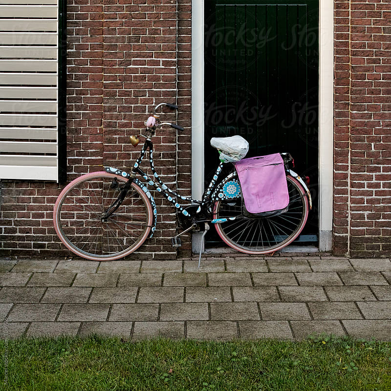 Decorated bicycle in front of a house by Marcel for Stocksy United