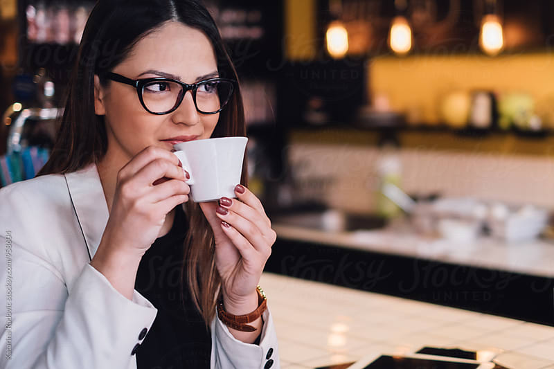 Beautiful Businesswoman Drinking Coffee by Katarina Radovic for Stocksy United