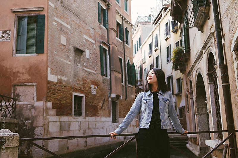 Portrait of beautiful chinese girl in Venice by Maa Hoo for Stocksy United