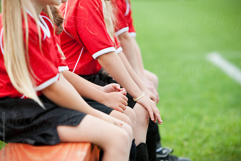 Soccer: Focus on Hands of Girl on Bench by Sean Locke for Stocksy United