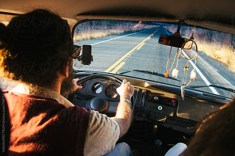 Traveling by Car - Male Bearded Hippie Driving Camper Van by VISUALSPECTRUM for Stocksy United