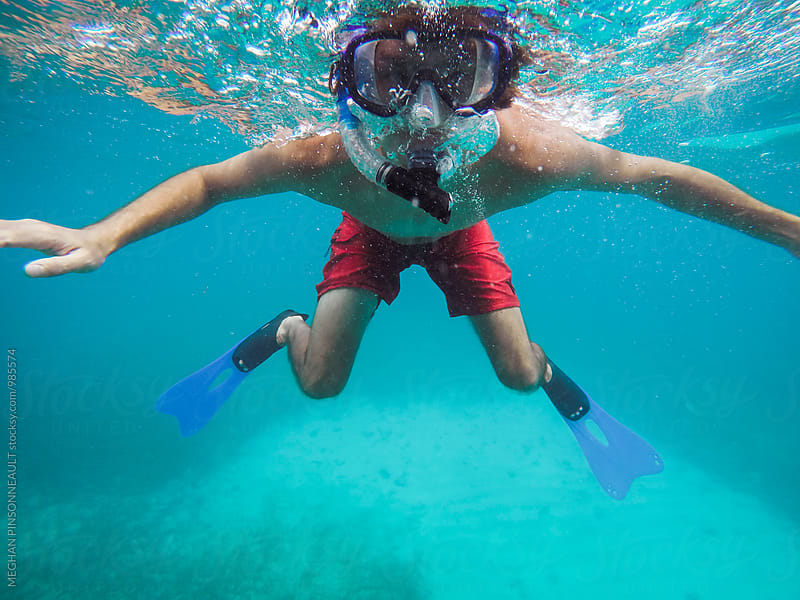 Man Snorkeling in Tropical Blue Waters by Meg Pinsonneault for Stocksy United