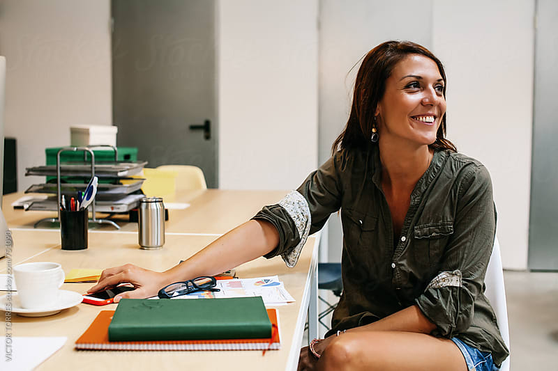 Happy Casual Businesswoman at the Office by Victor Torres for Stocksy United
