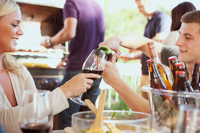 Party: Man Pouring Wine For Friend by Sean Locke for Stocksy United