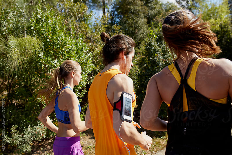 Rear View Of Athletes Running On Sunny Day by ALTO IMAGES for Stocksy United