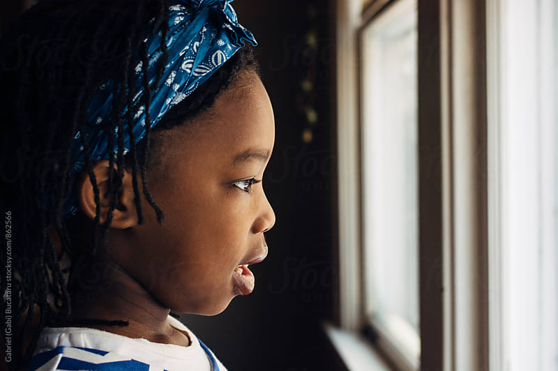 African American girl's profile looking out the window by Gabriel (Gabi) Bucataru for Stocksy United