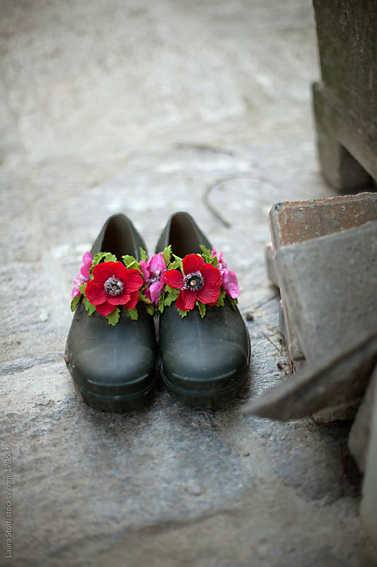 Rubber garden shoes decorated with flowers by Laura Stolfi for Stocksy United