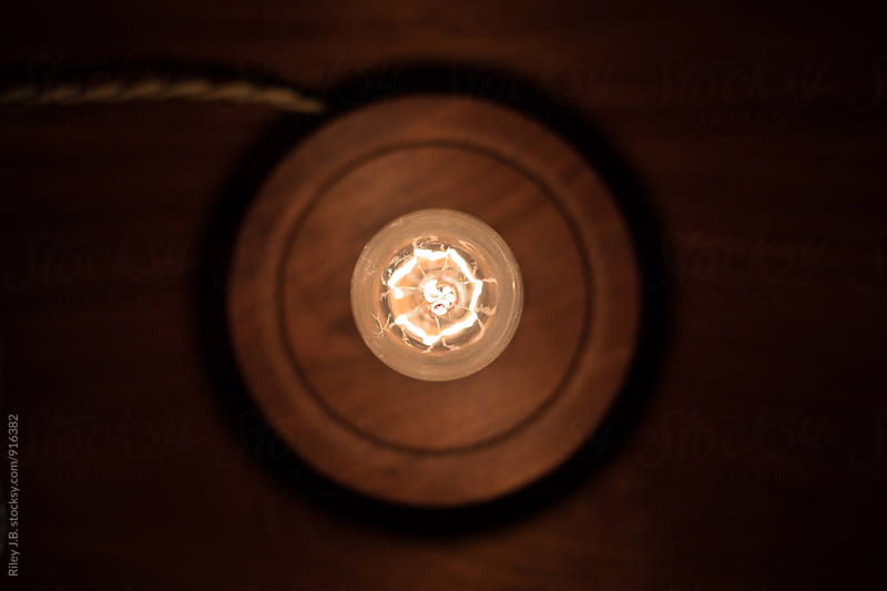Looking down at an Edison lightbulb from above by Riley J.B. for Stocksy United