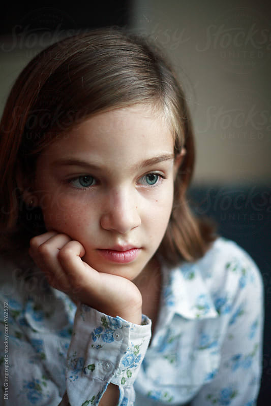 Young Girl Looking Bored With Hand Under Chin by Dina Giangregorio for Stocksy United