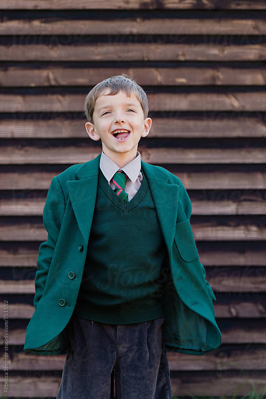 Cheeky school boy in his uniform by Rebecca Spencer for Stocksy United