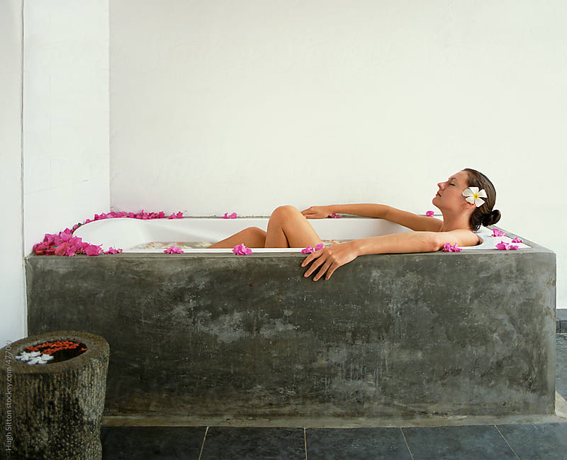 Woman relaxing in bath at spa. by Hugh Sitton for Stocksy United
