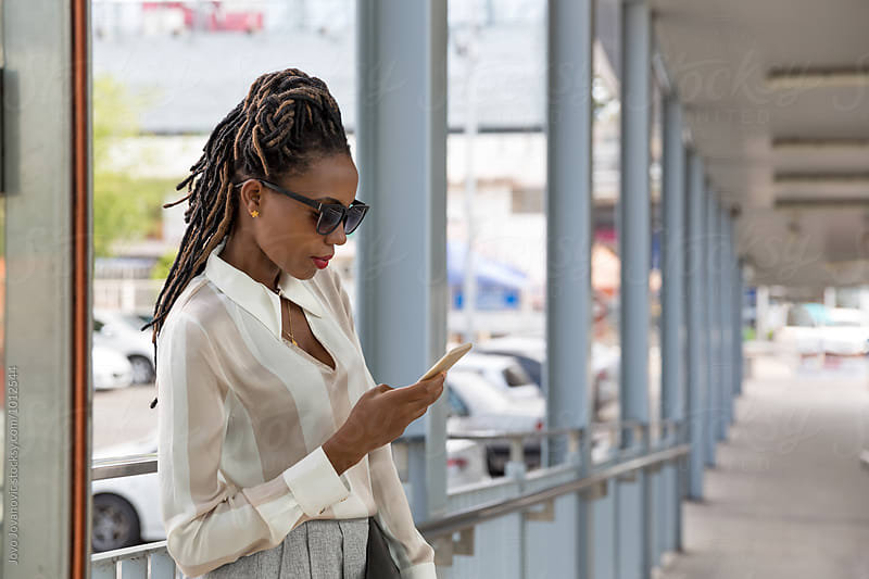 Young black businesswoman by Jovo Jovanovic for Stocksy United
