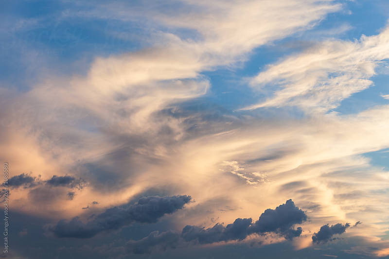 Dramatic cloud formation in the evening sky by Saptak Ganguly for Stocksy United